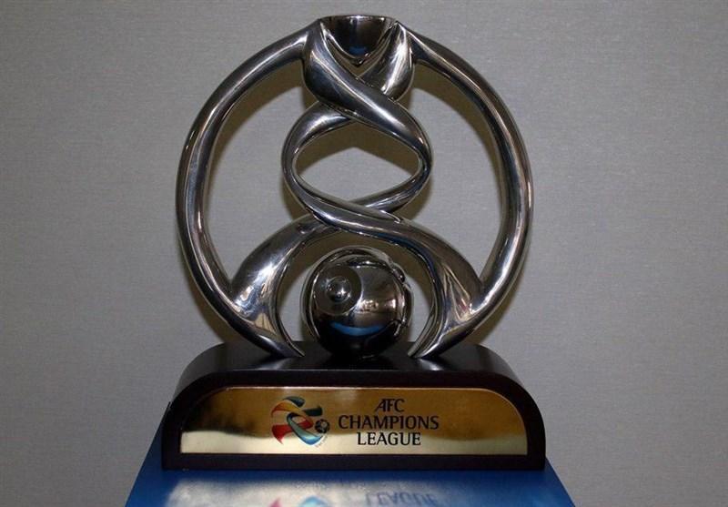پروین جام قهرمانی لیگ قهرمانان آسیا را روی سکو قرار می دهد